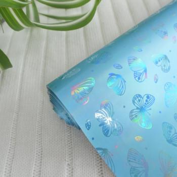 Кожзам блестящие бабочки голубой 30*57см